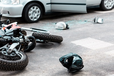 settlement for minor head and neck injuries after side swipe motorcycle crash in Wisconsin